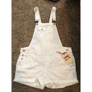 White denim overall shorts.
